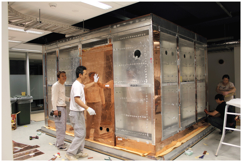 Figure 2 - Engineers building the magnetically shielded MEG room in our lab.