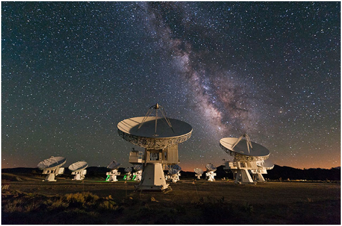 Figure 1 - The Milky Way. Astronomer José Francisco Salgado took this photo of the center of our Galaxy in Cedar Flat, Calif., on May 20, 2010. Below it stands the Combined Array for Research in Millimeter-wave Astronomy instrument made up of 23 radio telescopes.