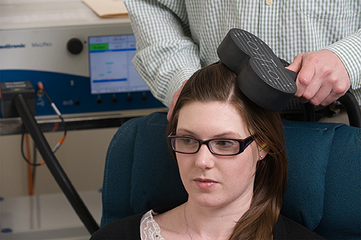 Figure 3 - A patient receiving transcranial magnetic stimulation.